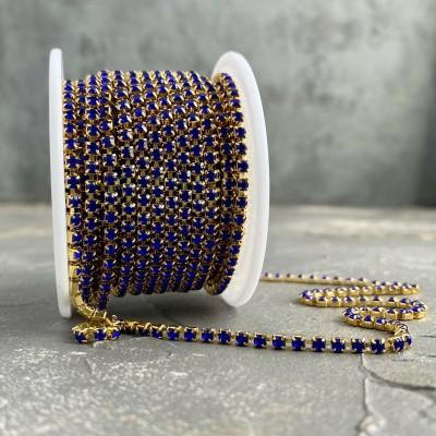 Стразовая цепь синий в золоте (SS10)